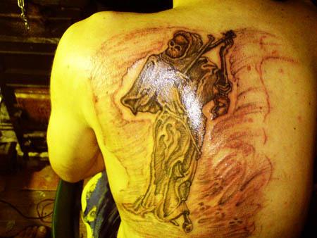 Tetovirani Marginalac, Siniša